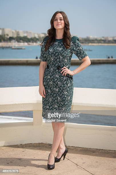 Heather Lind poses during the photocall of 'Turn' at MIPTV 2014 at Hotel Majestic on April 7 2014 in Cannes France