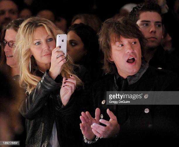 Heather Locklear and Richie Sambora watch their daughter Ava Sambora walk the runway at the White Trash Beautiful Spring 2011 Fashion Show held at...