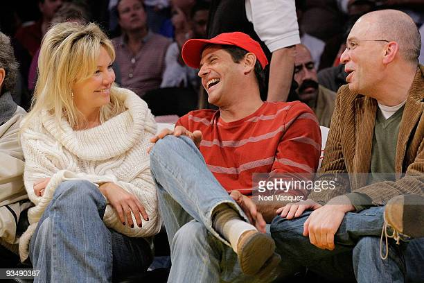 Heather Locklear and Thomas Calabro attend a game between the New Jersey Nets and the Los Angeles Lakers at Staples Center on November 29 2009 in Los...