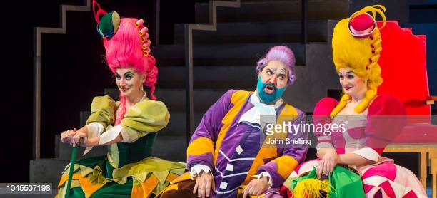 Heather Lowe as Tisbe Fabio Capitanucci as Don Magnifico and Aoife Miskelly as Clorinda perform on stage during the Welsh National Opera performance...