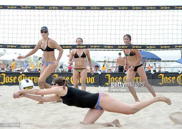 Heather Lowe watches a dig by teammate Tealle Hunkus in their match against Chelsea Hayes and Mariko Coverdale during the Manhattan Beach Open at...