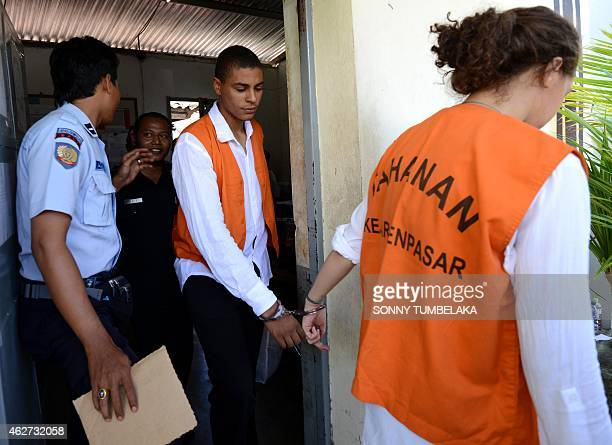 Heather Mack leads Tommy Schaefer of the US as they walk to a prison van at Kerobokan prison in Denpasar on Bali island on February 4, 2015. Schaefer...