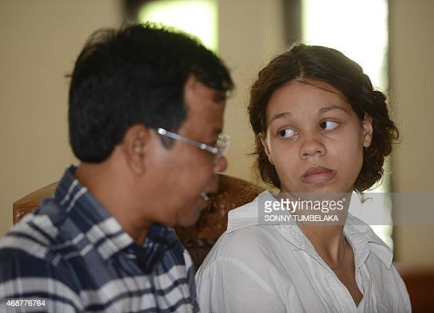 Heather Mack listens to her interpreter during her trial at Denpasar court on Bali island on April 7, 2015. Indonesian prosecutors have recommended a...