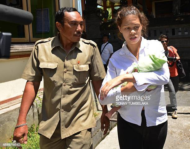 Heather Mack of the US carries her baby as she arrives for her trial at a Denpasar court on Indonesia's resort island of Bali on April 9, 2015....