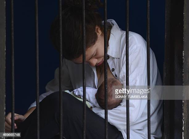 Heather Mack of the US holds her baby before her trial at a court in Denpasar on Bali island on April 14, 2015. Indonesian prosecutors recommended...