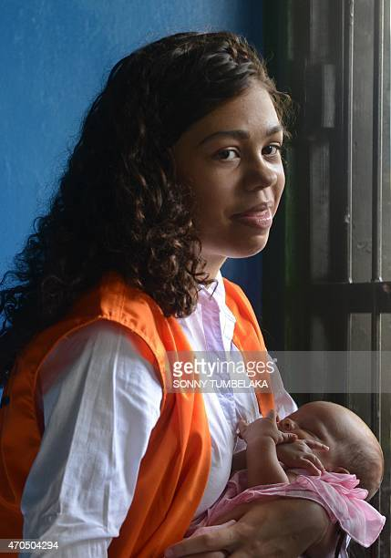 Heather Mack of the US holds her baby inside a holding cell before attending court in Denpasar on the resort island of Bali on April 21, 2015. Mack...