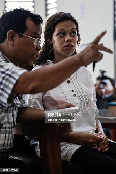 Heather Mack of the US listens to her translator during her sentence demand trial in a courtroom on March 31, 2015 in Denpasar, Bali, Indonesia....