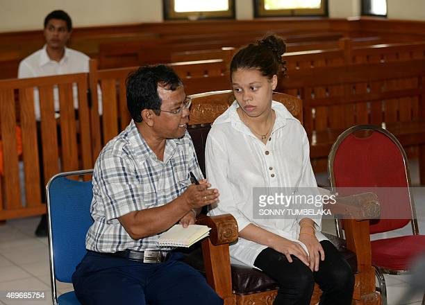 Heather Mack of the US speaks with an interpreter during her trial at a court in Denpasar on Bali island on April 14, 2015. Indonesian prosecutors...