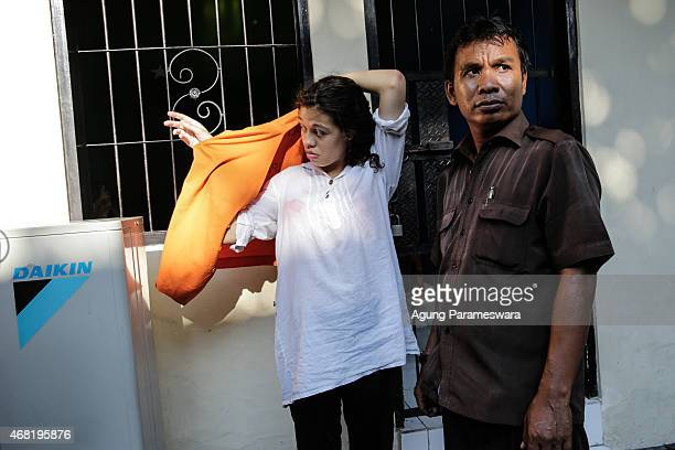 Heather Mack of the US wears a prisoner vest as she escorted by a court officer to courtroom for her sentence demand trial on March 31, 2015 in...
