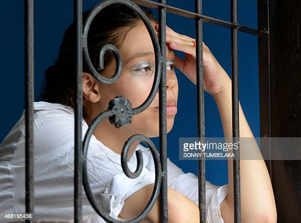 Heather Mack of US waits inside holding cell at a court in Denpasar on Bali island on March 31, 2015. Indonesian prosecutors have recommended a 15...