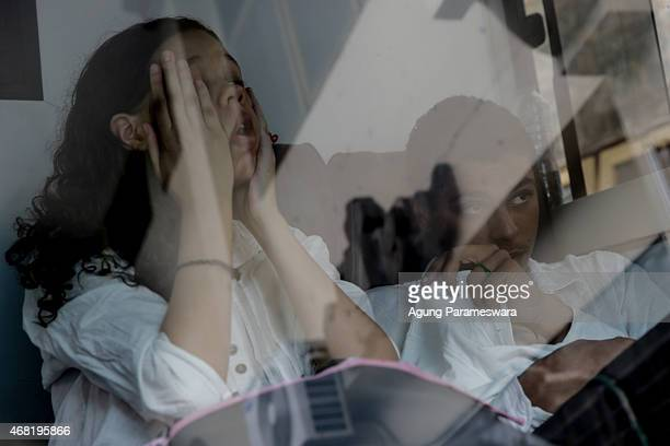 Heather Mack,19 and Tommy Schaefer both of the US arrive at a Denpasar district court to attend their sentence demand trial on March 31, 2015 in...