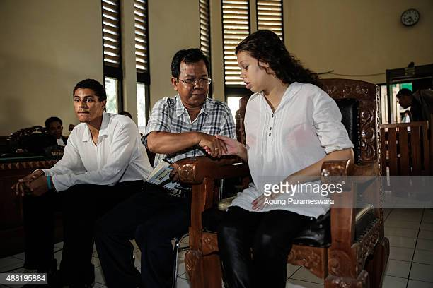 Heather Mack,19 and Tommy Schaefer both of the US sit in a courtroom with their translator during their sentence demand trial on March 31, 2015 in...
