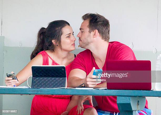 Heather Maltman sighted with her boyfriend Andrew Steele under a cabana while they work on their computers at Bronte on December 1 2015 in Sydney...