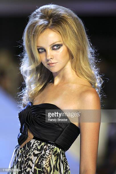 Heather Marks wearing Baby Phat Spring 2006 during Olympus Fashion Week Spring 2006 - Baby Phat - Runway at Radio City Music Hall in New York City,...