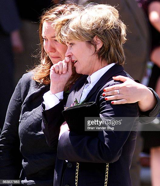 Heather Menzies right wife of late actor Robert Urich is comforted by a friend following memorial service at St Charles Catholic Church in North...