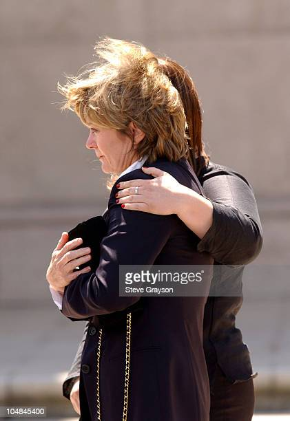 Heather Menzies widow of actor Robert Urich watches as his casket is put into a hearse after funeral services for the actor April 19 2002