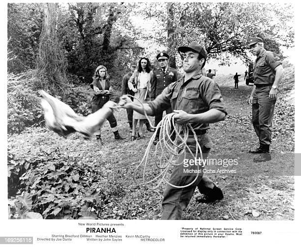 Heather MenziesUrich and Barbara Steele watch as men throw bait in the water in a scene from the film 'Piranha' 1978