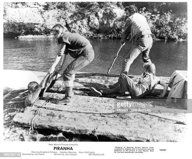 Heather MenziesUrich helps a person onto a raft while Bradford Dillman steers in a scene from the film 'Piranha' 1978