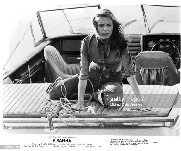 Heather MenziesUrich sits on the back of a boat in a scene from the film 'Piranha' 1978