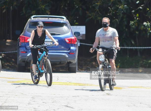 Heather Milligan and Arnold Schwarzenegger are seen on April 26 2020 in Los Angeles California