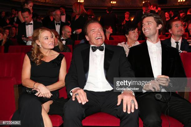 Heather Milligan, Arnold Schwarzenegger and Patrick Schwarzenegger arrive for the GQ Men of the year Award 2017 at Komische Oper on November 9, 2017...