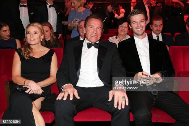 Heather Milligan Arnold Schwarzenegger and Patrick Schwarzenegger arrive for the GQ Men of the year Award 2017 at Komische Oper on November 9 2017 in...