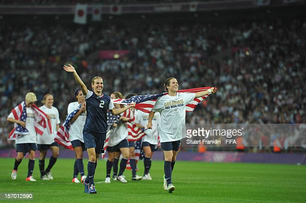 Heather Mitts and Kelley O'Hara of USA celebrate after the Olympic womens final match between USA and Japan on day 13 of the London 2012 Olympic...