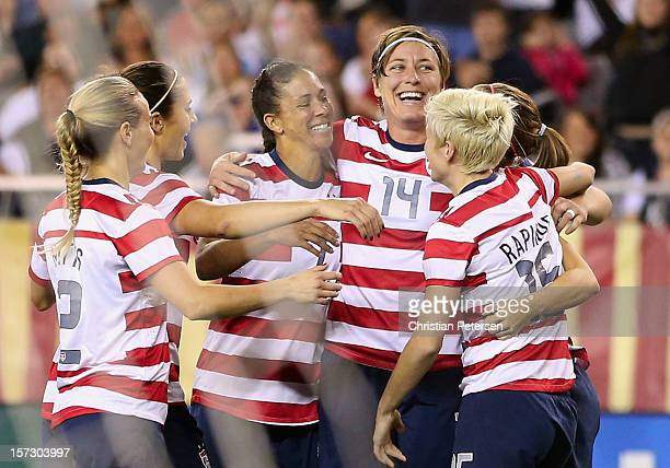 Heather Mitts Carli Lloyd Shannon Boxx Abby Wambach Alex Morgan and Megan Rapinoe of USA celebrate after Morgan scored a first half goal against...