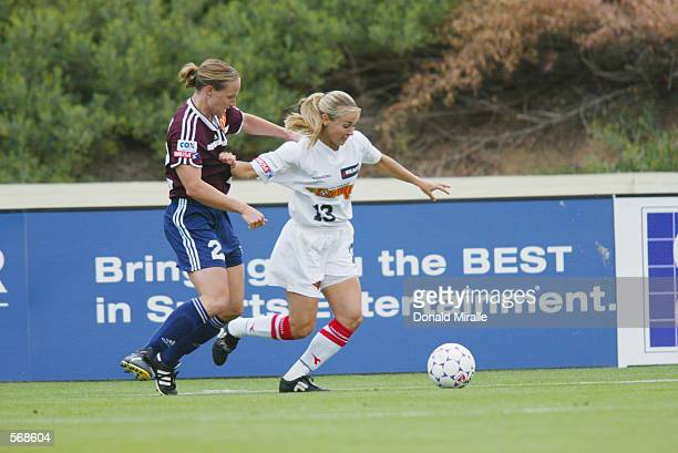 Heather Mitts of the Philidelphia Charge and Amy Sauer of the San Diego Spirit battle for the ball in their WUSA game at Torero Stadium at the...