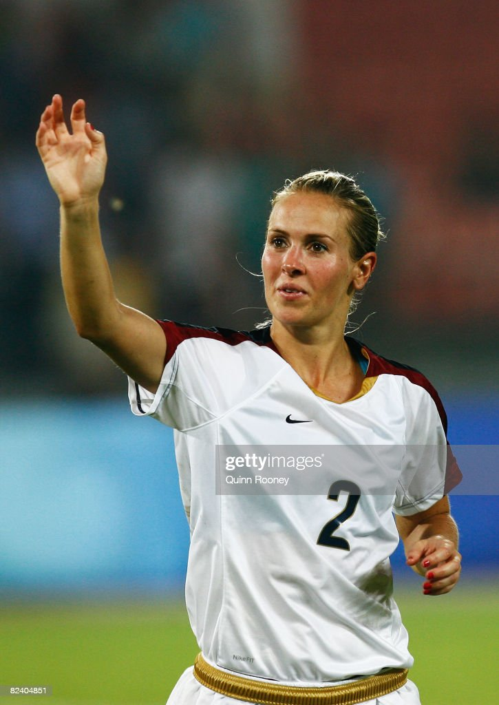 Heather Mitts of the United States celebrates victory after the Women's Semi Final match between Japan and the United States at the Workers' Stadium on Day 10 of the Beijing 2008 Olympic Games on August 18, 2008 in Beijing, China.