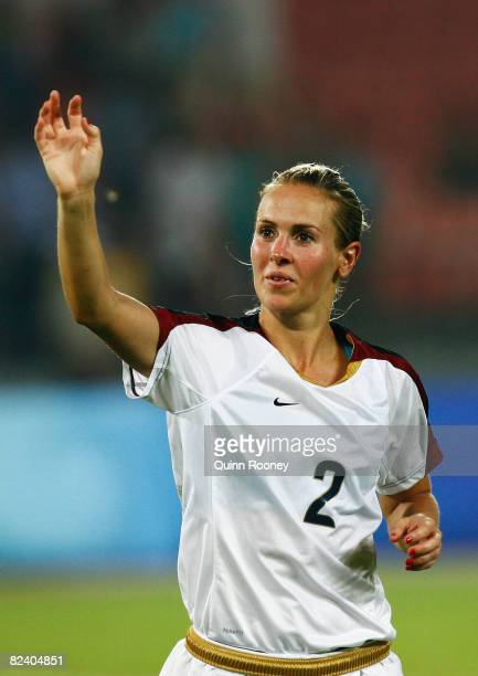 Heather Mitts of the United States celebrates victory after the Women's Semi Final match between Japan and the United States at the Workers' Stadium...