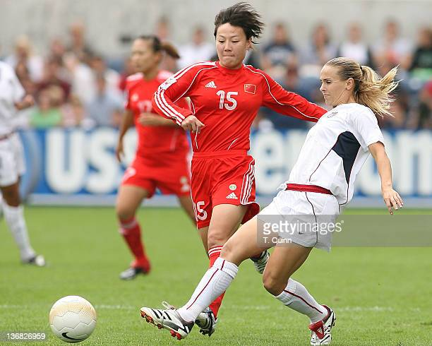 Heather Mitts of the United States knocks the ball away from Liping Ren of China as the US Women's National Team crushed arch rivals People's...