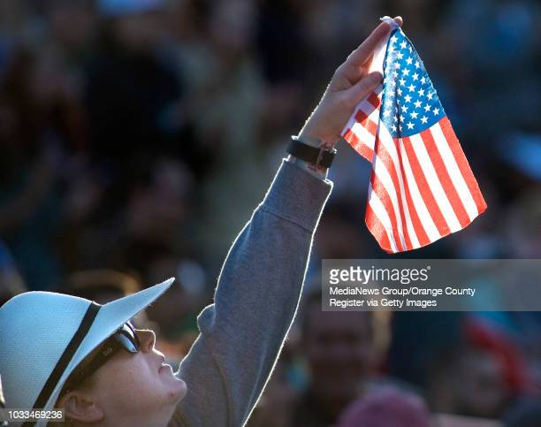 Heather Morgan of Los angeles waves Old Glory as Bernie Sanders speaks at a rally on Sunday in Irvine. ///ADDITIONAL INFO: - Photo by MINDY SCHAUER,...