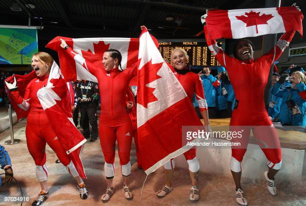 Heather Moyse and Kaillie Humphries of Canada 1 celebrate gold and Helen Upperton and ShellyAnn Brown of Canada 2 celebrate silver after the women's...