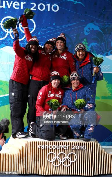 Heather Moyse and Kaillie Humphries of Canada 1 celebrate gold Helen Upperton and ShellyAnn Brown of Canada 2 celebrate silver and Erin Pac and Elana...