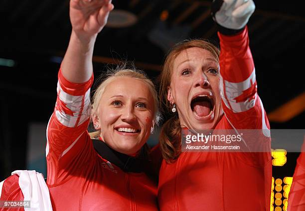 Heather Moyse and Kaillie Humphries of Canada celebrate winning gold during the women's bobsleigh on day 13 of the 2010 Vancouver Winter Olympics at...