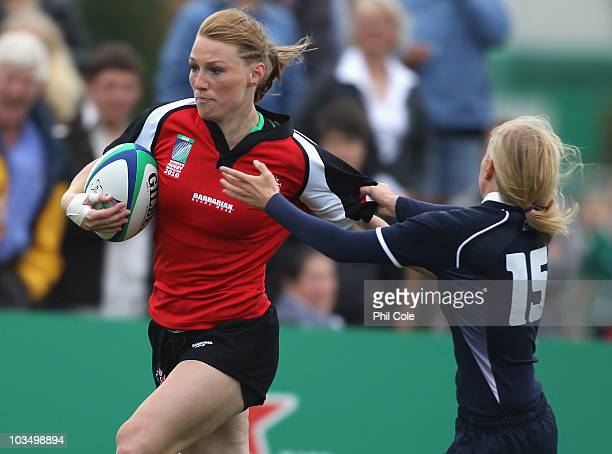 Heather Moyse of Canada goes past Nicola Halfpenny of Scotland and scores a try during the Women's Rugby World Cup 2010 Pool C Match between Canada...