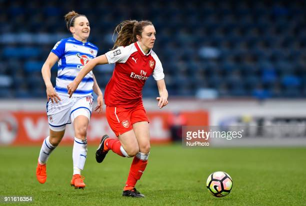 Heather O'Reilly of Arsenal battles for possession with Lauren Bruton of Reading FC Women during Women's Super League 1 match between Reading FC...