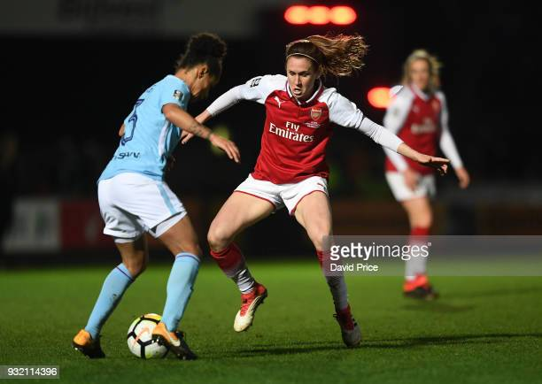 Heather O'Reilly of Arsenal takes on Demi Stokes of Man City during the match between Arsenal Women and Manchester City Ladies at Adams Park on March...