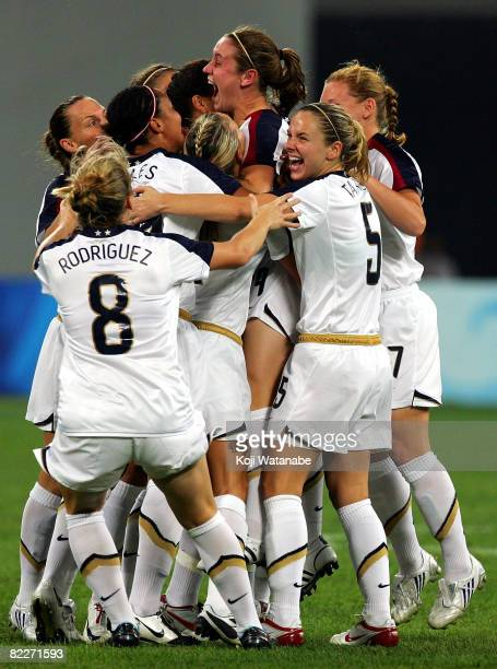 Heather O'Reilly of the United States celebrates the first goal with teammates during the Women's Group G match between USA and New Zealand on Day 4...