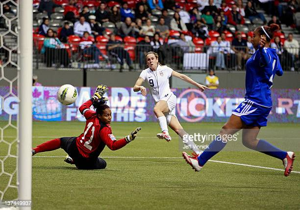 Heather O'Reilly of the United States scores on Heidy Salazar of the Dominican Republic while Lissy Sanchez of the Dominican Republic watches during...