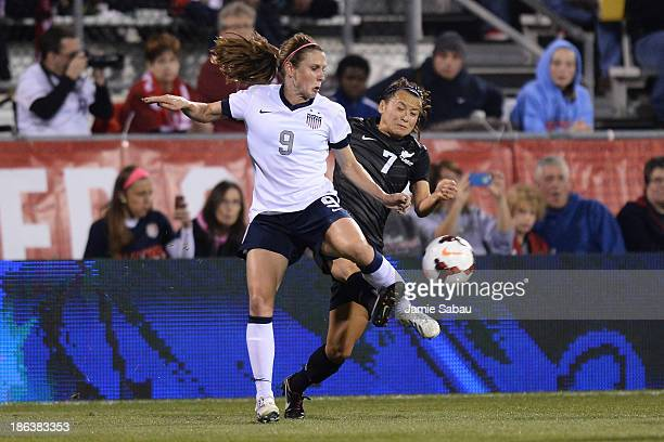 Heather OÕReilly of the US WomenÕs National Team and Ali Riley of the New Zealand WomenÕs National Team battle for control of the ball in the first...