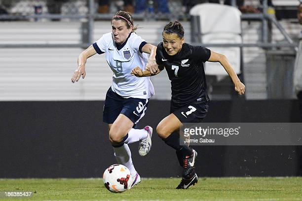 Heather OÕReilly of the US WomenÕs National Team and Ali Riley of the New Zealand WomenÕs National Team battle for control of the ball in the second...