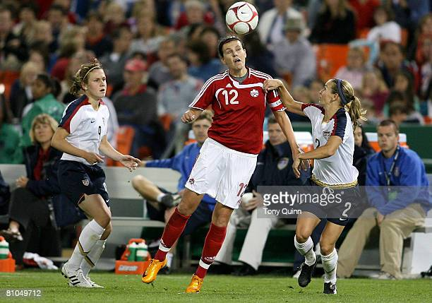 Heather O'Reilly of USA watches Christine Sinclair of Canada head the ball past teammate Heather Mitts during an international friendly match on May...