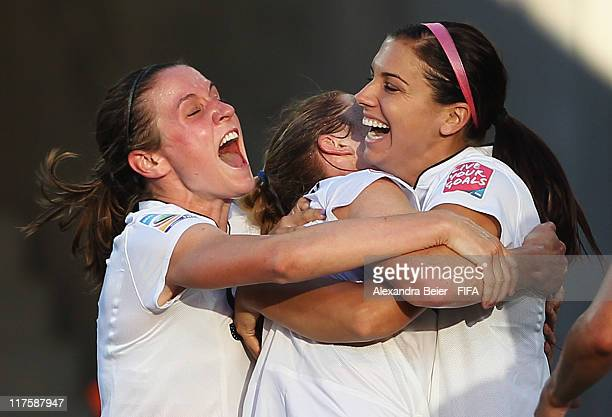 Heather O'Reilly Rachel Buehler and Alex Morgan of USA celebrate Buehler's goal against Korea DPR during the FIFA Women's World Cup 2011 Group C...