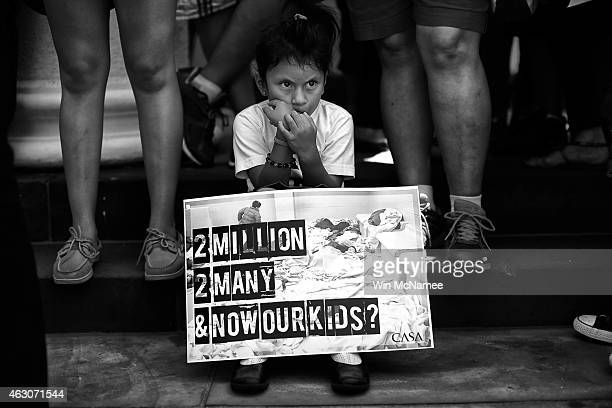Heather Pia Ledezma age 4 and from Mexico joins immigration reform protesters at a rally July 7 2014 in Washington DC Participants condemned...
