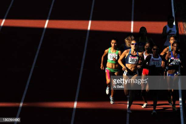 Heather Rae Kampf of the United States and Adriana Munoz of Cuba lead the field in the women's 800m final during Day 11 of the XVI Pan American Games...