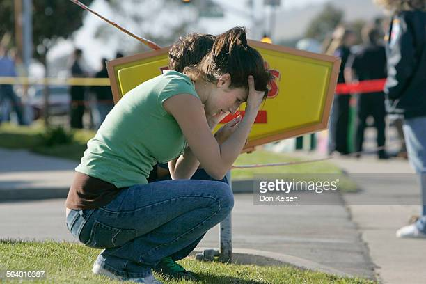 – Heather Redden,18 of Pismo Beach with Cody Ferraro, 19 of Arroyo Grande on the lawn in front Denny's restaurant, Pismo Beach where unknown gunman...