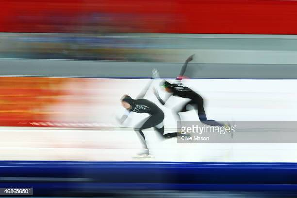 Heather Richardson and Lauren Cholewinski of the United States compete during the Women's 500m Race 2 of 2 Speed Skating event during day 4 of the...
