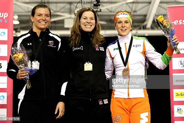 Heather Richardson Christine Nesbitt of Canada and Ireen Wust of the Netherlands pose on the winner's podium after the 1000 meter race during the...
